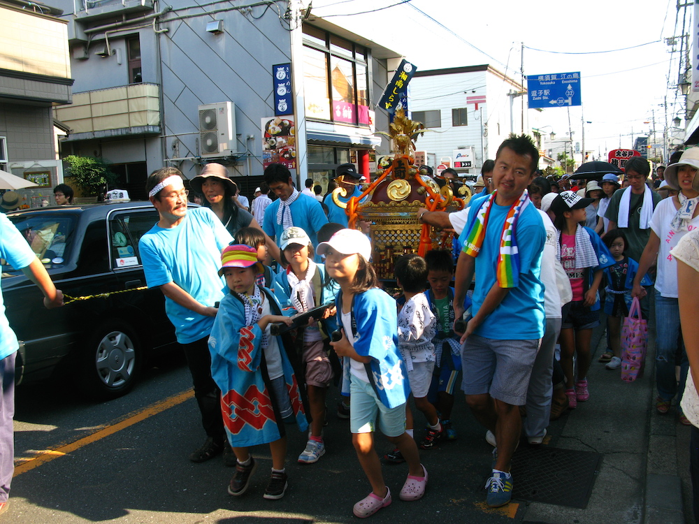 Kids show their spirit a good time as they parade through the streets