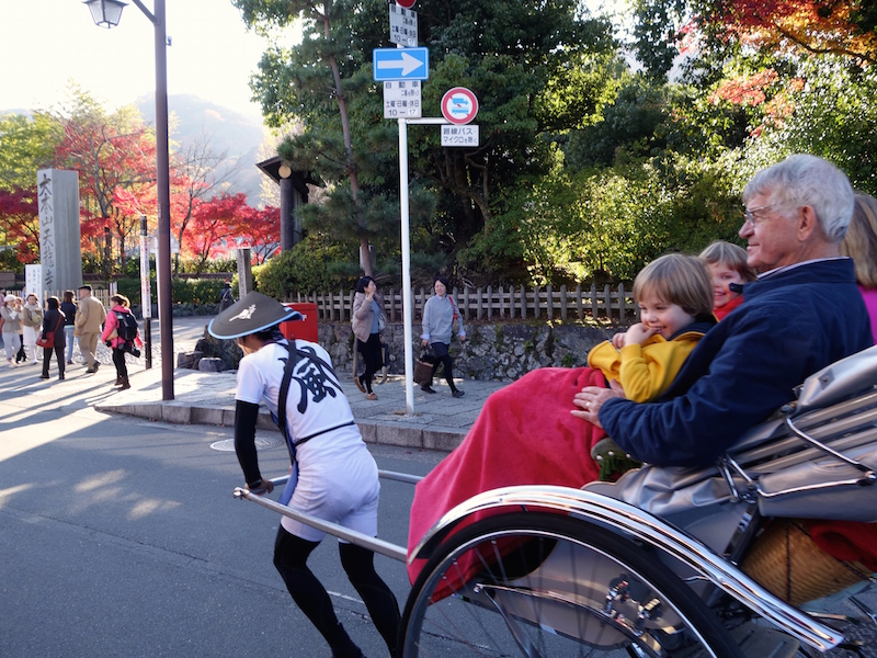We came out of the temple just in time to see the kids fly by on a rickshaw ride with their grandparents.