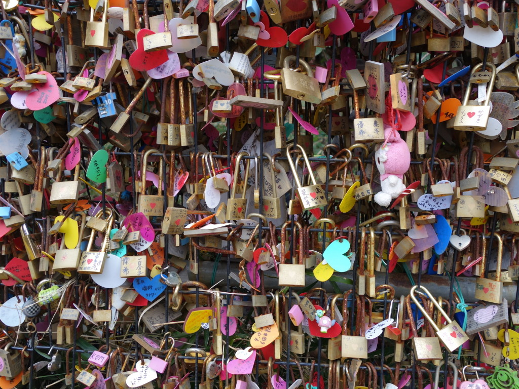 People bring locks to lock to a fence to symbolize their love (like the dragon, who fell in love and became a nice guy).